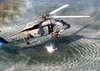 A Search And Rescue (sar) Swimmer Prepares To Jump From An Sh-60b  Seahawk  Helicopter Image