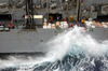 Sailors Aboard The Fast Combat Support Ship Uss Sacramento (aoe 1) Work To Maintain Control Of The Lines In High Winds And Heavy Seas During An Underway Replenishment (unrep) Image