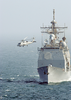 An Sh-60b Departs The Uss Normandy Image