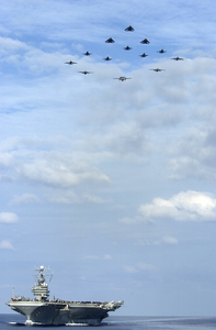 Aircraft Aboard Uss George Washington, Execute A Formation Fly-by Above The Aircraft Carrier. Image