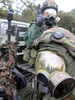 Seabees Assigned To Naval Mobile Construction Battalion Forty (nmcb-40) Don Protective Suits During A Simulated Chemical/biological Attack Conducted During A Field Training Exercise Image
