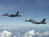 F/a-18f Super Hornets Assigned To The Black Aces Conduct In-flight Refueling Exercises Over Iraq Image