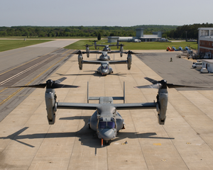 Four V-22 Osprey Aircraft Sit Along The Flight Line With Rotors Turning Before Recent Test Flights Image