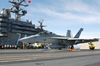 An F/a-18f Launches From The Ship Image