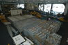 The Hangar Bay Aboard The Nuclear Powered Air Craft Carrier Uss George Washington (cvn 73) Is Staged With Weapons Transferred From The Military Sealift Command Ship Usns Supply (t-aoe 6) Image