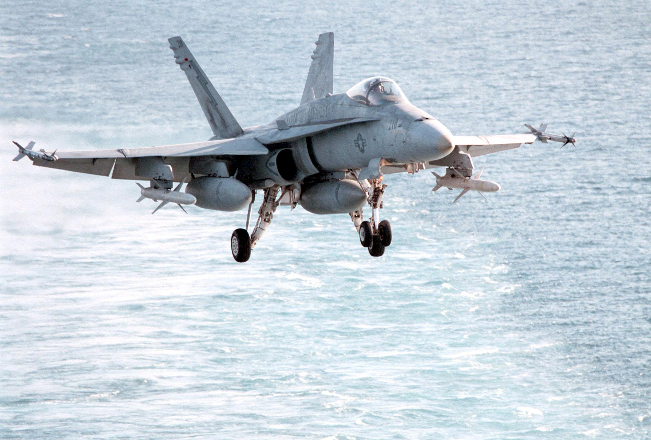 f  a-18 hornet on final approach for a carrier landing