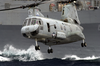 A Ch-46 Sea Knight Carries Supplies And Stores During A Vertical Replenishment (vertrep) Image