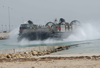 A Landing Craft, Air Cushion (lcac) Assigned To Assault Craft Unit Five (acu-5) Transports Equipment. Image