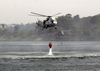 Two Uh-3h Sea King Helicopters Assigned To The Golden Gaters Of Helicopter Combat Support Squadron Eighty Five (hc-85) Dip Their Bambi Bucket Into A Lake To Aid In The Firefighting Effort. Image