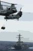 Two Ch-46d Sea Knight Helicopters Cross Paths While Transferring Cargo Clip Art