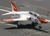 A T-45c Goshawk Makes An Arrested Landing On The Flight Deck. Clip Art