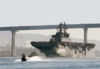 The Amphibious Assault Ship Passes Under The Coronado Bridge As She Makes Her Way Out Of The San Diego Bay Clip Art