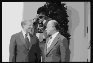 [president Jimmy Carter And Israeli Prime Minister Menachem Begin Talk At The White House, Washington, D.c., As A Photographer Adjusts His Camera In The Background] Clip Art
