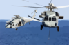 Two Mh-60s Knighthawk Helicopters Assigned To The  Providers  Of Helicopter Composite Squadron Five (hc-5) Pass One Another During A Replenishment Detail With Uss Kitty Hawk (cv 63) Clip Art