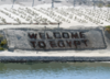 Welcome To Egypt Is Clearly Marked To Show That The Suez Canal Offers Safe Passage To Those Who Transit The Waterway, Which Is Used Daily By A Variety Of Ships, From Commercial Vessels To Military Warships. Clip Art
